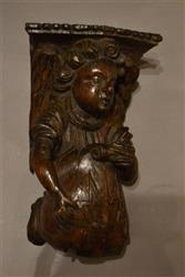 An Elizabethan angel carved with merchant's marks.