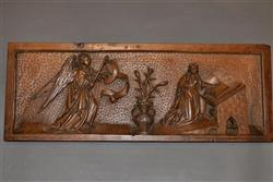 A very fine walnut depiction of The Annunciation.