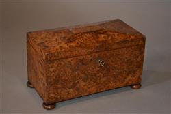 A fine Regency burr elm tea caddy.