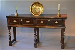 A small James II oak dresser base.