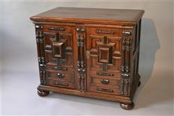 A Charles II oak enclosed chest of drawers.