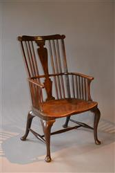 An impressive Thames Valley comb back armchair.