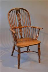 An early 19th century yew wood Windsor armchair.