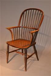 An early 19th century stick back Windsor armchair.