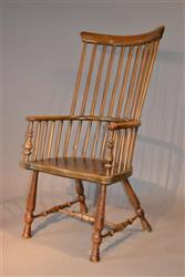 A mid 19th century Scottish comb back armchair.