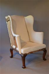 A George II walnut wing back armchair.