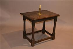 A Charles II oak centre table.