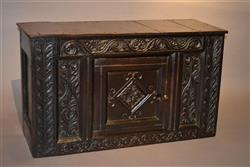 A mid 17th century oak mural food cupboard.