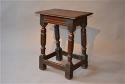A mid 17th century oak joint stool.