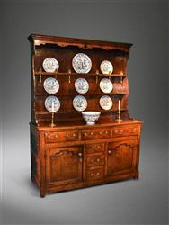 An early 18th century oak Welsh dresser and rack.