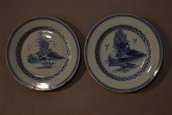 A pair of 18th century English delft plates.