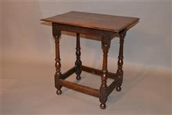 A small early 18th century oak centre table.