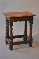 A Charles II oak joint stool.