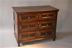 A Charles II oak chest of drawers.