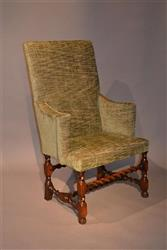 An early 18th century upholstered armchair.