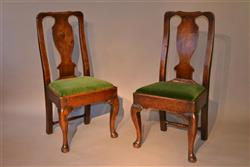 A pair of George II walnut side chairs.