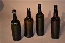 Four 18th/19th century wine bottles.