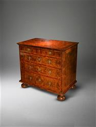 A William and Mary olivewood chest of drawers.