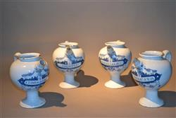 A rare set of 18th century tin glazed syrup jars.