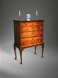 A George I walnut chest on stand.