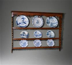 A mid 18th century oak delft rack.