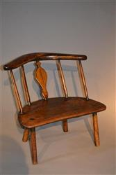 A very unusual George III primitive chair.