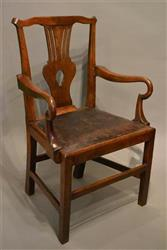 A George III elm shepherd's crook armchair.